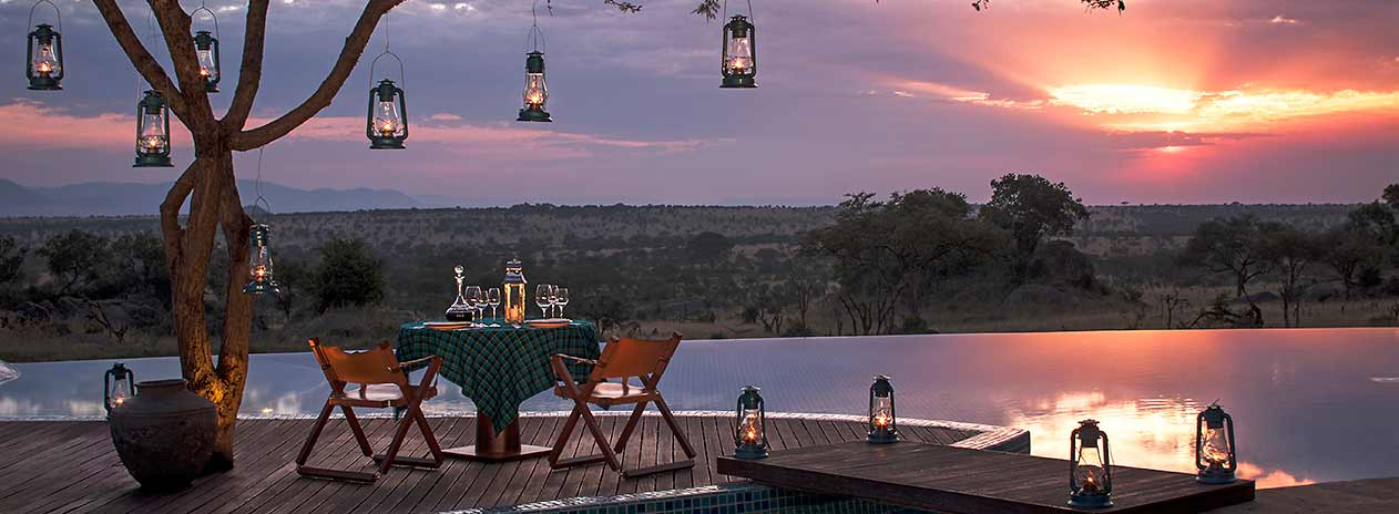 Serengeti Four Seasons Safari Lodge Sunset with view over lake